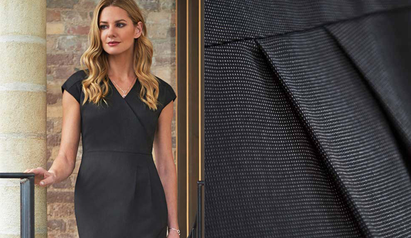 Brook Taverner Cressidea dress with capped sleeves, v-neck and front pleat crossover detail..